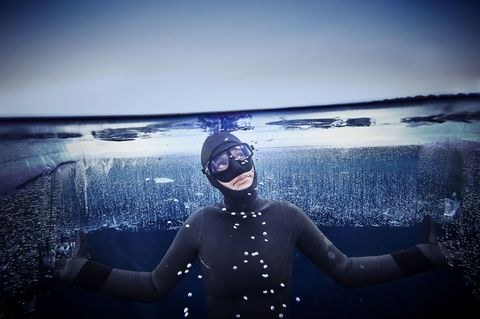 Goggles, Personal protective equipment, Diving equipment, Cool, Underwater, Flash photography, Underwater diving, Water sport, Costume, Wetsuit,
