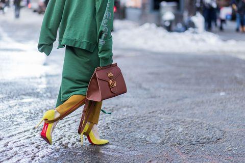 Human leg, Bag, Textile, Outerwear, Winter, Street fashion, Luggage and bags, Fashion, Maroon, Tan,