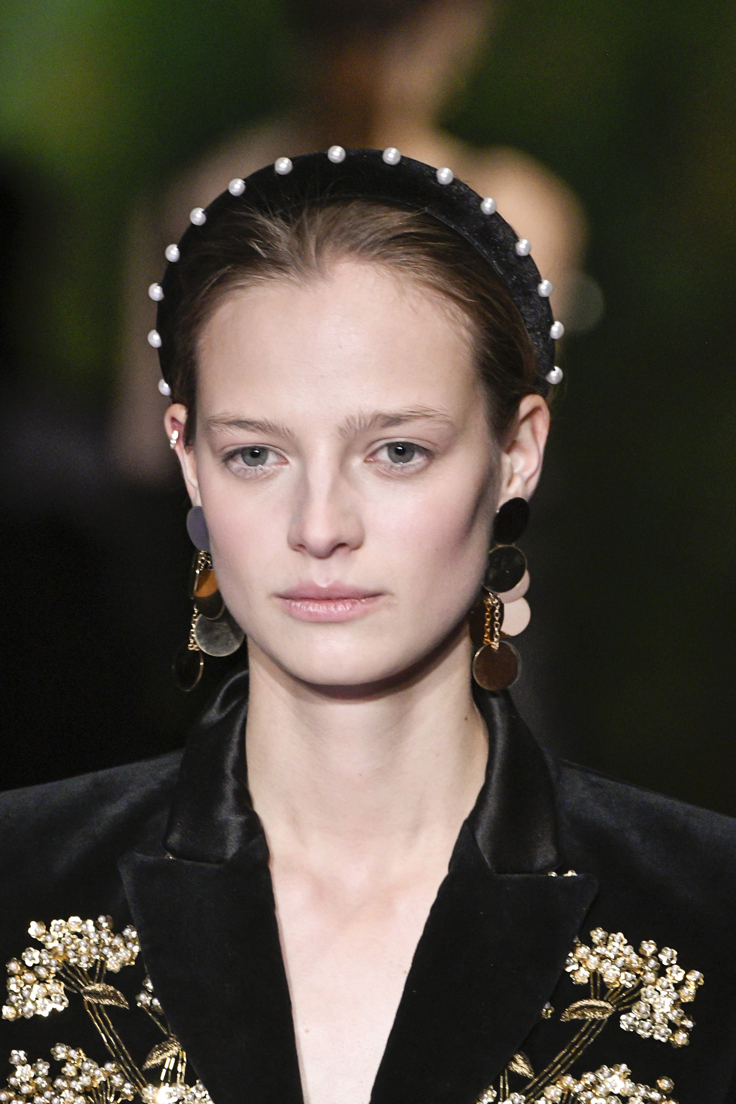 <p>With some top notes of Vermeer. A large contingent of commenters ran screaming from the '80s-ness of it all, but we think with the right, smart outfit, and those earrings, a pearl headband could be really elegant.   </p>
