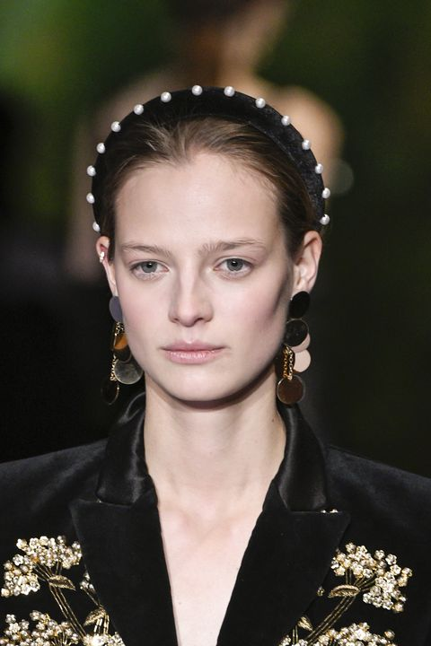 <p>With some top notes of Vermeer. A large contingent of commenters ran screaming from the '80s-ness of it all, but we think with the right, smart outfit, and those earrings, a pearl headband could be really elegant. &nbsp;&nbsp;</p>