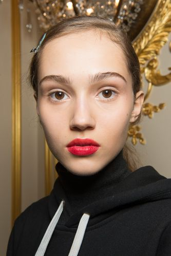 """<p>To create the two-toned lip look at Jason Wu, makeup artist Yadim applied Maybelline's <a href=""""http://bit.ly/2kDEGPi"""" target=""""_blank"""" data-tracking-id=""""recirc-text-link"""">Color Sensational Vivid Matte Liquid</a> in <a href=""""http://bit.ly/2kDEGPi"""" target=""""_blank"""" data-tracking-id=""""recirc-text-link"""">Orange Obsession</a>($7.99) to the top lip, blending it with his fingers. Then, hepatted the same formula in <a href=""""http://bit.ly/2kDEGPi"""" target=""""_blank"""" data-tracking-id=""""recirc-text-link"""">Red Punch</a> on the bottom lip for a color-blocked effect.</p>"""