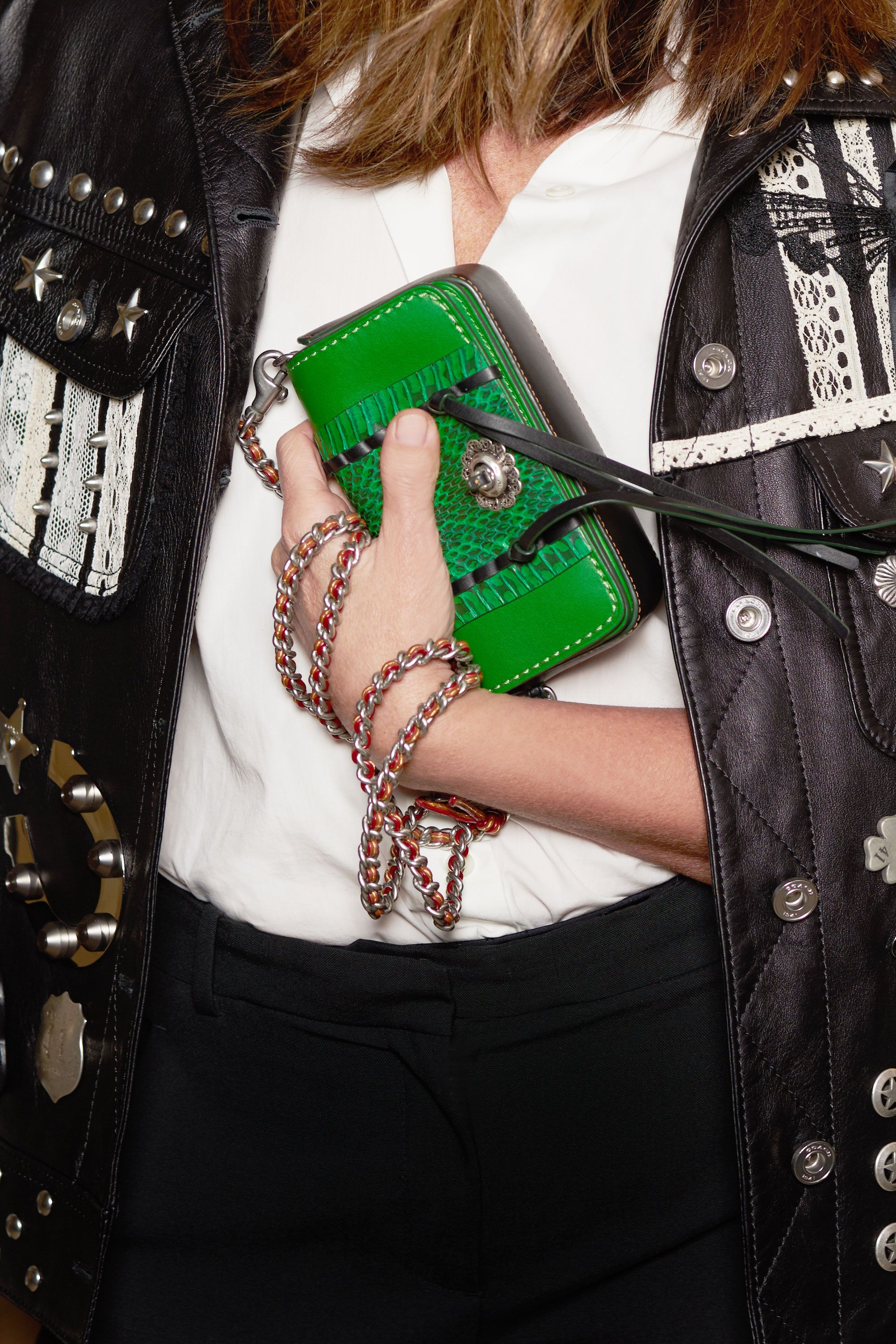 """<p>Repeat after us: Less is more. Garcia and some of the best-dressed women in the fashion week front rows often arrive to with little more than their invitation and a cell phone in-hand. The takeaway here is editing down your life's essentials to fit inside a mini bag. Garcia's crossbody adds a fun pop of color to her monochrome outfit—and offers hands-free functionality. <em data-redactor-tag=""""em"""">Coach Whipstitch Snake Dinkier, $550, <a href=""""http://www.coach.com/shop/women-coach1941-new-arrivals?CID=D_B_MRC_12405"""" target=""""_blank"""" data-tracking-id=""""recirc-text-link"""">coach.com</a></em></p>"""