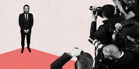 Arm, Photographer, Digital camera, Formal wear, Camera, Lens, Single-lens reflex camera, Blazer, Reflex camera, Camera lens,