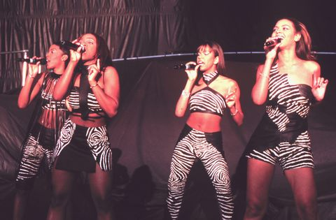 <p>Here's Bey performing with Destiny's Child at one of the band's first-ever shows (this one was in Mountain View, California) on their 1998 tour—back when the girls all wore coordinating outfits. </p>
