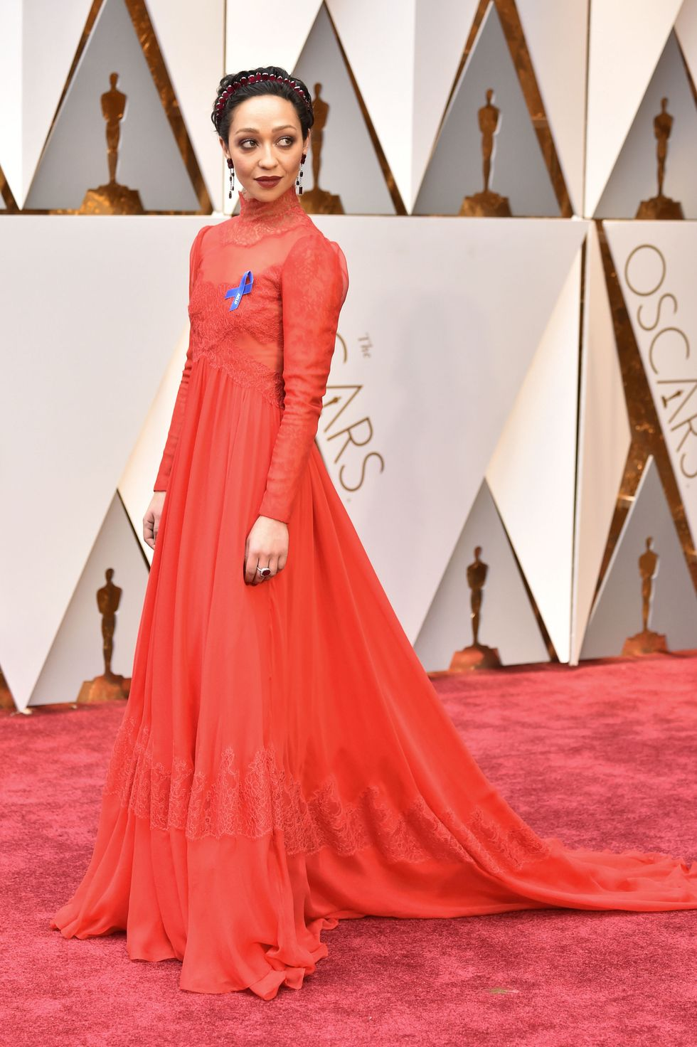 Ruth Negga, 2017 Ruth Negga made sure her appearance at the Oscars was not one to be forgotten, thanks to this lacy high-neck scarlet dress from Valentino with a romantic sweeping train and a Renaissance-style headband.