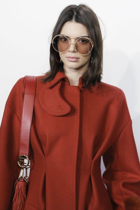 Eyewear, Clothing, Orange, Outerwear, Fashion, Coat, Glasses, Overcoat, Sunglasses, Sleeve,