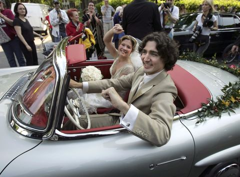 MONTREAL, QC - MAY 28: Justin Trudeau and bride Sophie Gregoire leave the Sainte-Madeleine D'Outremont Church, Montreal, after their wedding ceremony here, May 28, 2005. The car a 1959 Mercedez 300SL, was Pierre Trudeua's car and was recently renovated and given its original silver grey colour.        (Bernard Weil/Toronto Star via Getty Images)