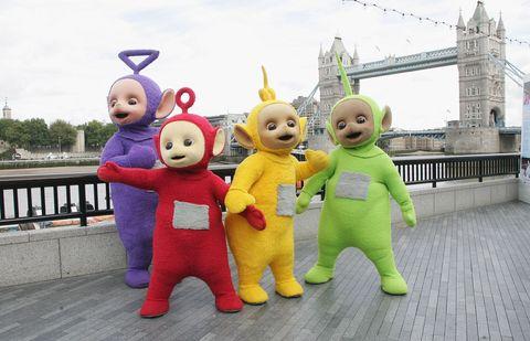 Mascot, Yellow, Animated cartoon, Costume, Fun, Stuffed toy, Animation, Child, Toy, Happy,