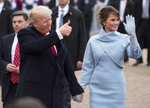 Face, Sleeve, Coat, Suit, Formal wear, Gesture, Tie, Blazer, Greeting, Holding hands,