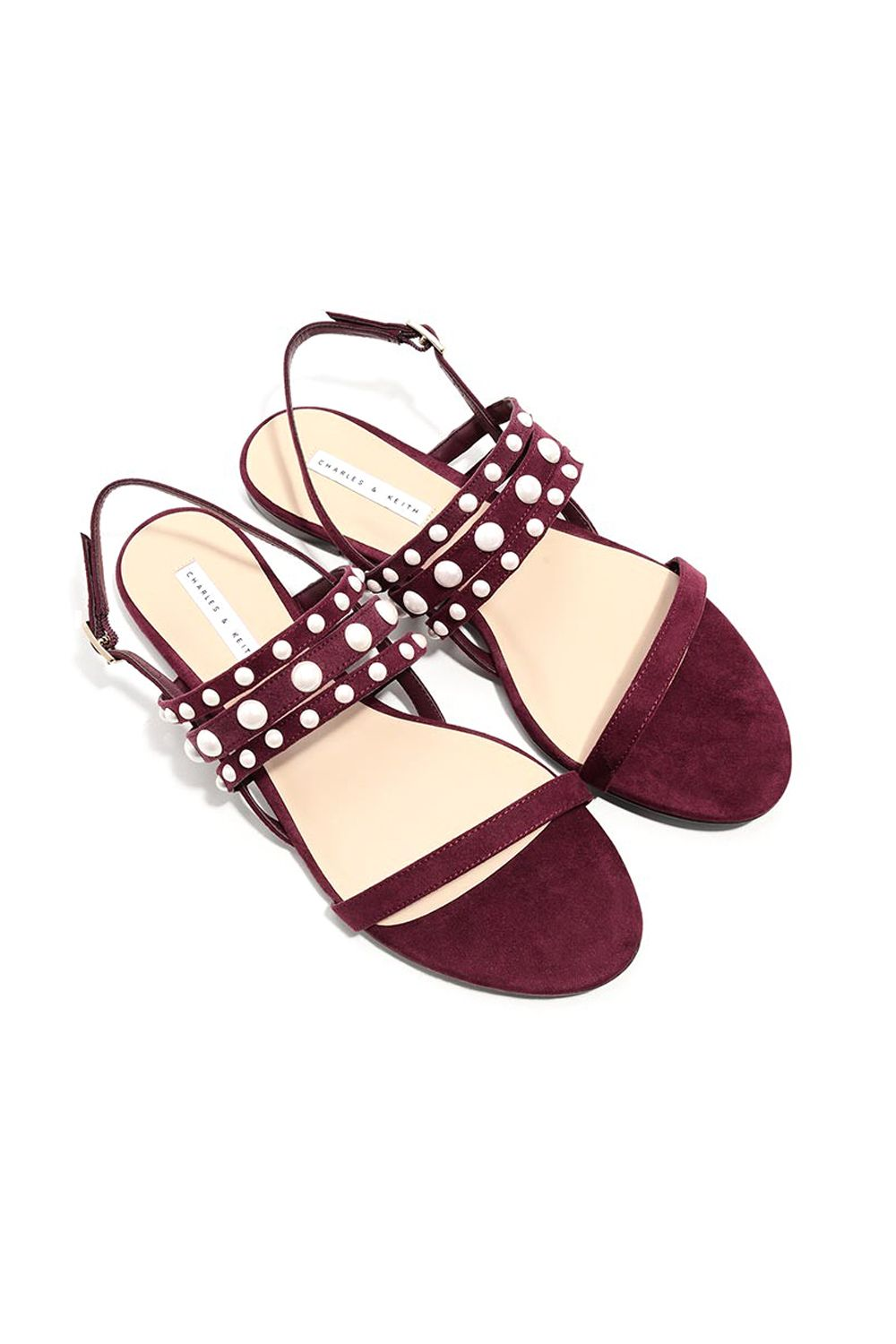 "<p>&nbsp&#x3B;At a most un-Chanel price.&nbsp&#x3B;</p><p>$39, <a href=""http://www.charleskeith.com/us/shoes/sandals/pearl-detail-sandals.html"" target=""_blank"" data-tracking-id=""recirc-text-link"">charleskeith.com</a>.</p>"