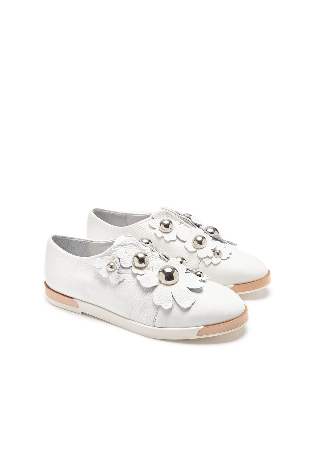 "<p>The latest in beautiful white sneakers (which are definitely worth the perpetual dirt dilemma)&nbsp&#x3B;are topped with summery white florals.&nbsp&#x3B;</p><p><strong data-redactor-tag=""strong"" data-verified=""redactor"">Blanche White Slip-Ons, $295&#x3B; <a href=""https://usa.miista.com/collections/flats/products/blanche-white-flats"" target=""_blank"" data-tracking-id=""recirc-text-link"">miista.com</a>.</strong></p>"
