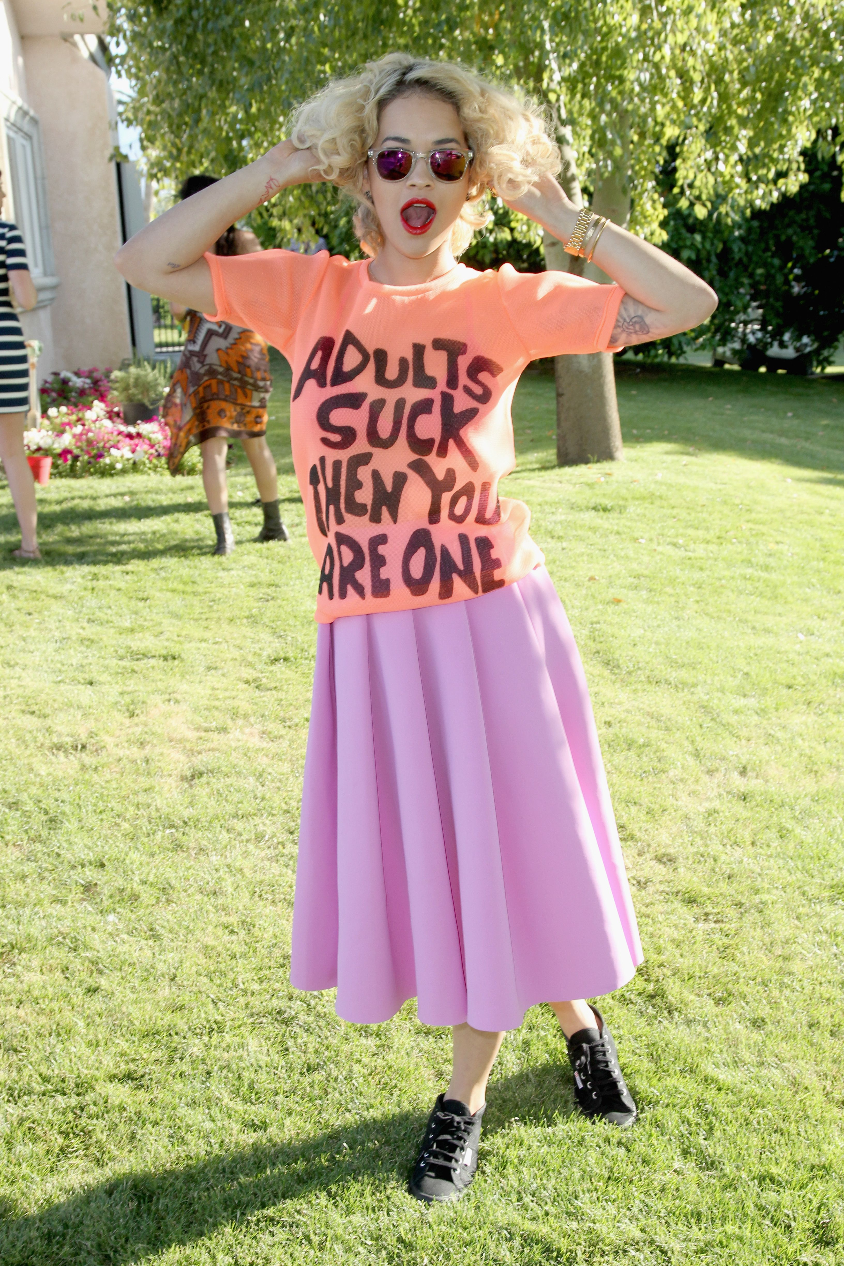 """Rita Ora If you're of the """"more is more"""" mentality, do as Rita Ora does and wear a graphic tee with an equally bright midi skirt."""