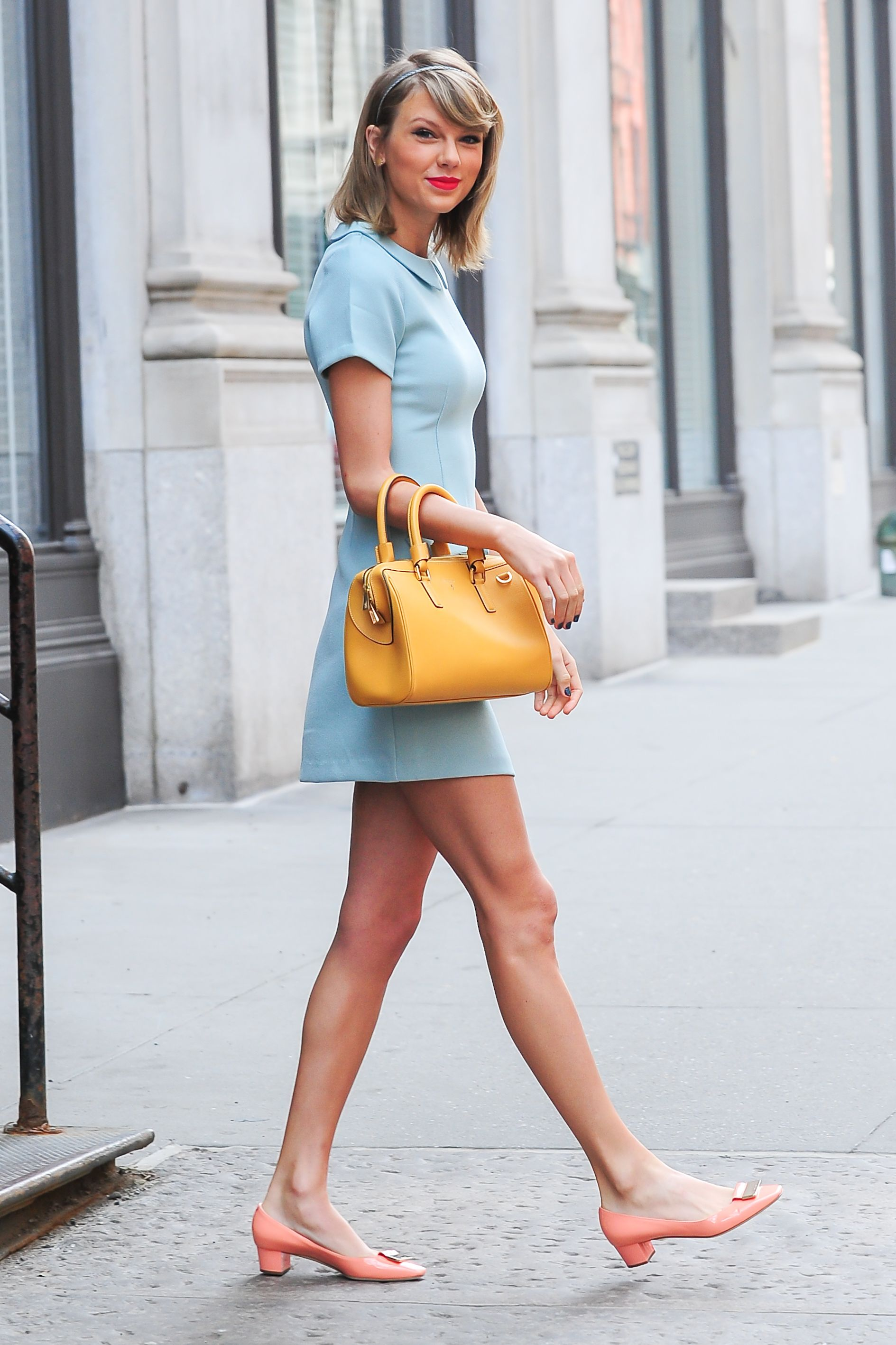 Taylor Swift Play with cool pastels and bright accessories (and let's not forget the red lip) all in one look when you're already over the color white.