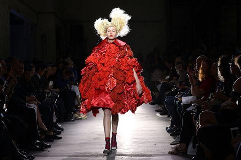 Fashion, Fashion model, Runway, Fashion show, Red, Haute couture, Event, Fashion design, Dress, Model,