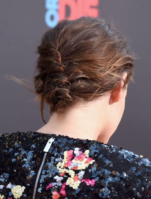 <p>A loose modified French twist (running top to bottom instead of vice versa) makes the most of her air-dried texture. </p>
