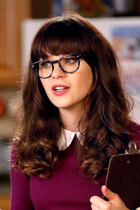 <p>Zooey Deschanel has such thick, shiny, and long strands, it's hard to believe they're not hair extensions. And while bangs are her signature IRL, we love how they complement fictional Day's big, bouncy curls. Her life may be in shambles, but you'd never know it thanks to her polished coils.</p>