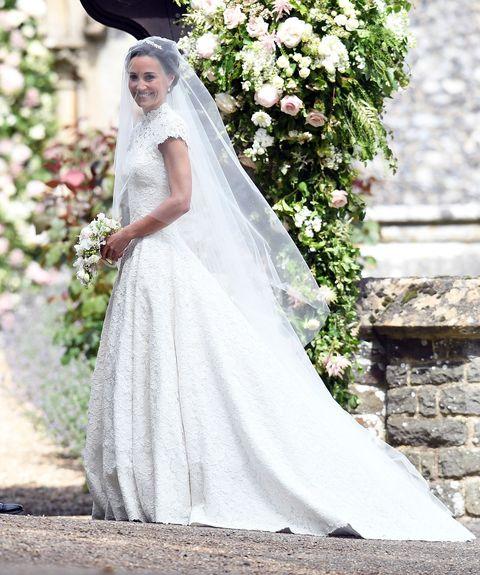 Wedding dress, Bride, Gown, Dress, Clothing, Photograph, Bridal clothing, White, Veil, Bridal accessory,