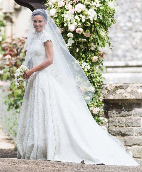 Clothing, Bridal veil, Dress, Bridal clothing, Veil, Petal, Photograph, Bride, Wedding dress, Formal wear,