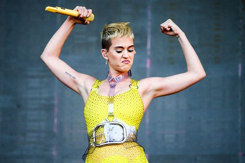 Yellow, Muscle, Performance, Arm, Dancer, Performing arts, Abdomen,