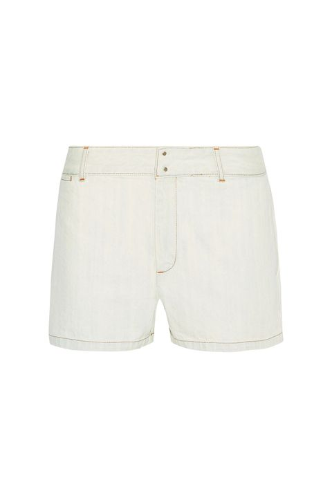 """<p>As with everything else the French&nbsp;brand produces, these are the platonic ideal. So for once in your life, try not to drip&nbsp;hot dog juice onto the bleached denim.</p><p>APC, $130; <a href=""""https://www.net-a-porter.com/us/en/product/812383/a_p_c__atelier_de_production_et_de_creation/mini-denim-shorts"""" target=""""_blank"""" data-tracking-id=""""recirc-text-link"""">net-a-porter.com</a>.</p>"""
