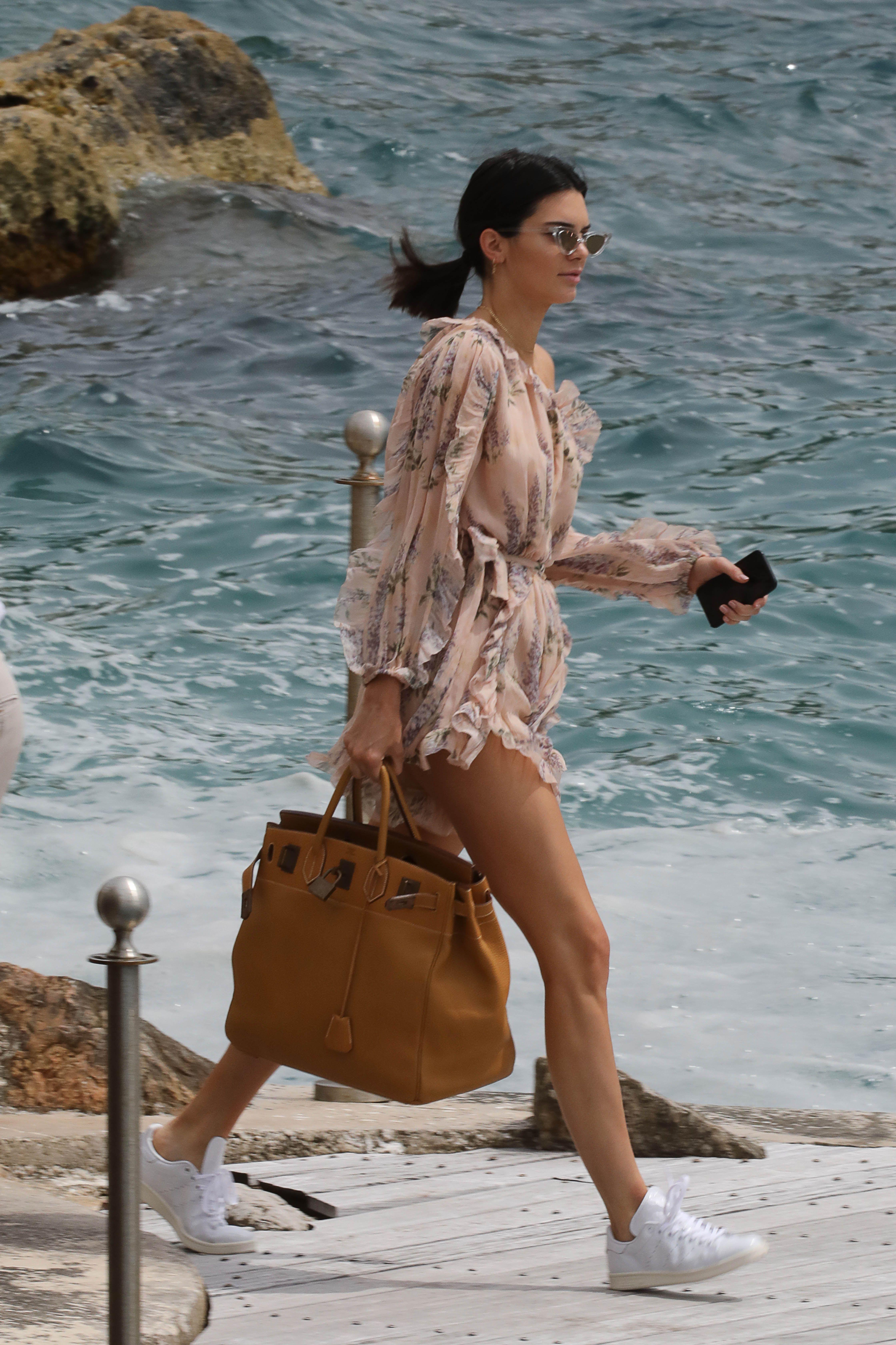 Kendall Jenner A flowy romper or shirt-dress is peak effortless summer dressing.