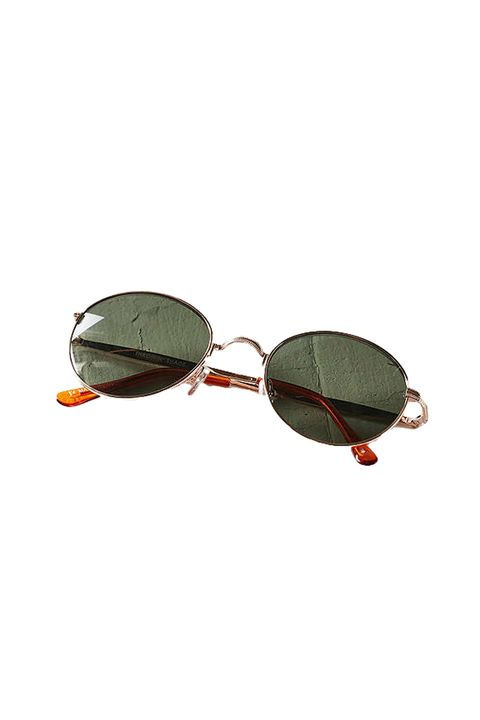"<p>Honey, I shrunk the lenses so you might have to perch them on the tip of your nose to make them flattering.&nbsp;</p><p>Urban Outfitters, $19; <a href=""https://www.urbanoutfitters.com/shop/1992-slim-oval-sunglasses?category=womens-sunglasses&amp;color=070"" target=""_blank"" data-tracking-id=""recirc-text-link"">urbanoutfitters.com</a>.</p>"