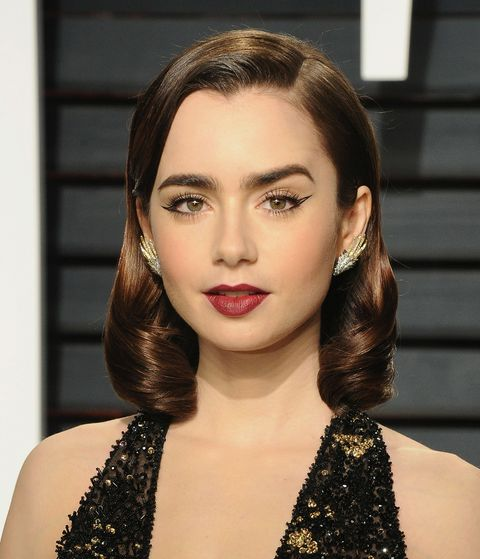 <p>We begin with Miss Lily Collins, who is doing those glassy waves pretty much true to form. (Why are they still such a crowdpleaser? Easy—because Old Hollywood glamour never dies, and it goes so well with so many kinds of dresses, it is basically the Nudist sandal of hair.) So yes, this means that you could still do exactly the same hair now, and it would be modern by virtue of you being a 21st-century woman. However...</p>