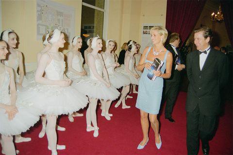 Fashion, Dress, Event, Fun, Ceremony, Red carpet, Flooring, Gown, Leg, Fashion design,