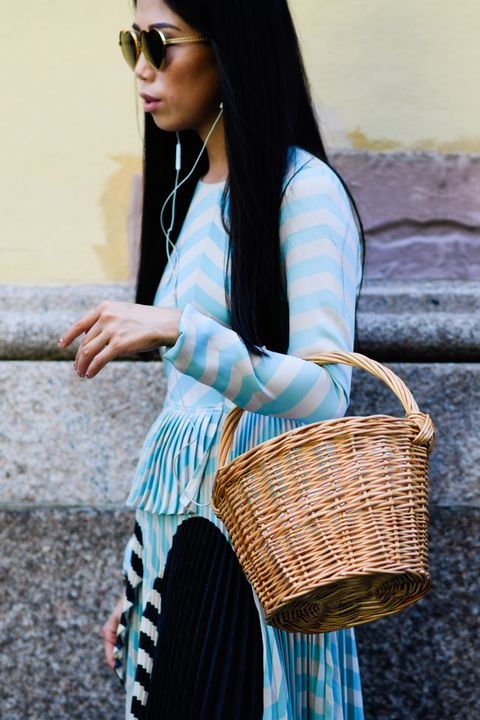 """<p>On the handbag front, Aiken is a fan of the city basket. """"<strong data-redactor-tag=""""strong"""" data-verified=""""redactor"""">It's one of those classic summer essentials, but it has become more structured and refined for the city streets</strong>. <a href=""""https://www.net-a-porter.com/us/en/Shop/Designers/Muun?pn=1&amp;npp=60&amp;image_view=product&amp;dScroll=0"""" data-tracking-id=""""recirc-text-link"""">Muun</a> and <a href=""""https://www.net-a-porter.com/us/en/Shop/Designers/Cult_Gaia?pn=1&amp;npp=60&amp;image_view=product&amp;dScroll=0"""" data-tracking-id=""""recirc-text-link"""">Cult Gaia</a> are two of our favorite brands!""""</p>"""