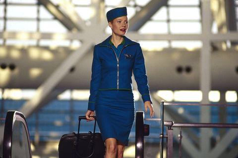 Fashion, Workwear, Street fashion, Flight attendant, Denim, Travel, Headgear, Uniform, Electric blue, Baggage,