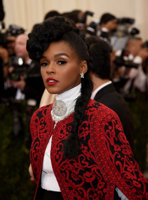 "<p>The bigger and bolder, the better, says the wisdom of Janelle Moná<span class=""redactor-invisible-space"" data-verified=""redactor"" data-redactor-tag=""span"" data-redactor-class=""redactor-invisible-space""></span>e. Here she piles a tilted braid atop her head and lets the rest hang down on her shoulders in a side braid. </p>"