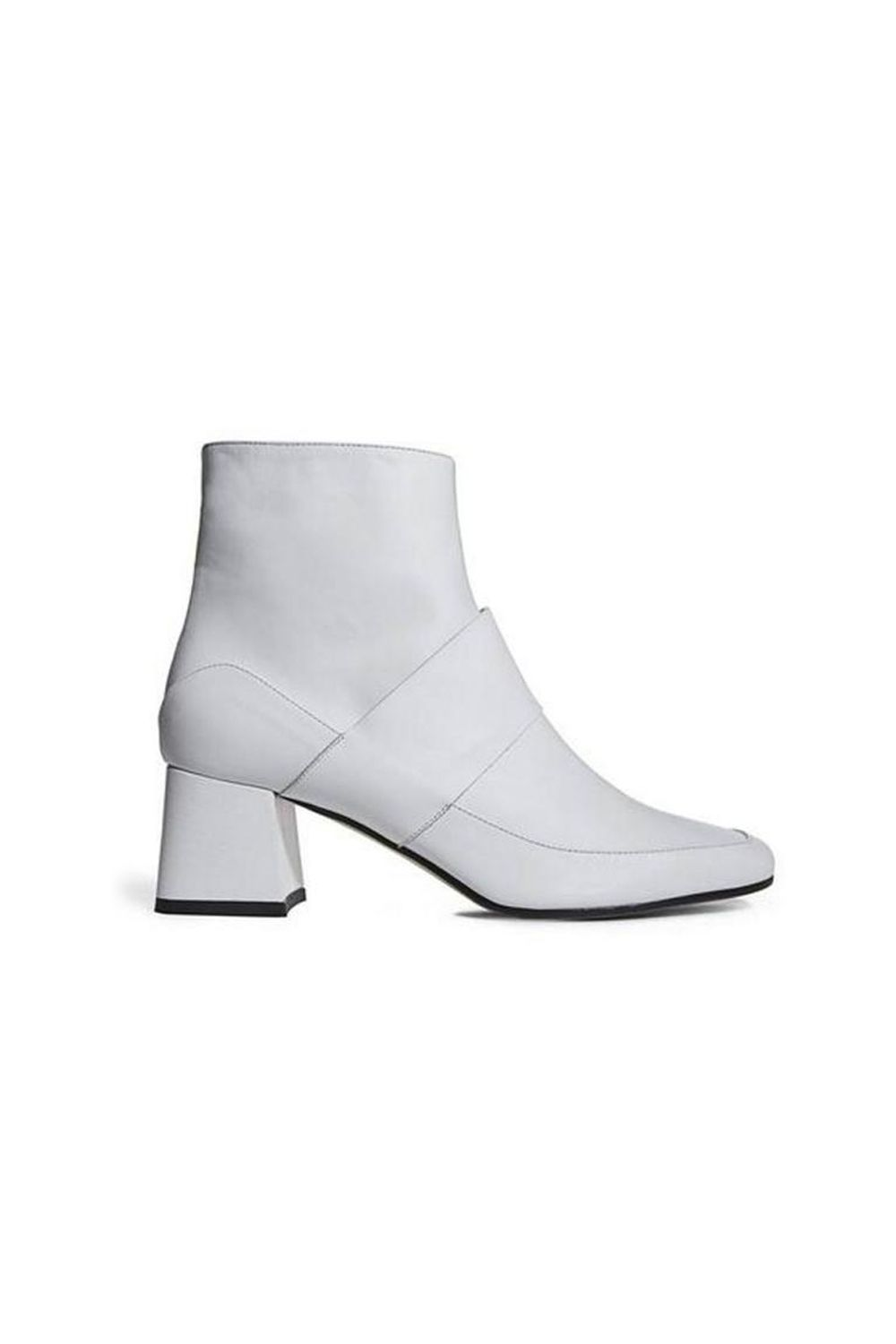 "<p>Shout it from the rooftops: Get you a white boot. </p><p><em data-redactor-tag=""em"" data-verified=""redactor"">ASKA Collection, $450</em><span class=""redactor-invisible-space"" data-verified=""redactor"" data-redactor-tag=""span"" data-redactor-class=""redactor-invisible-space""><em data-redactor-tag=""em"" data-verified=""redactor""></em></span><br></p><p><strong data-redactor-tag=""strong"" data-verified=""redactor"">BUY IT: <a href=""https://askacollection.com/collections/booties/products/goldie?variant=26325228678"" target=""_blank"">askacollection.com</a>.</strong></p>"