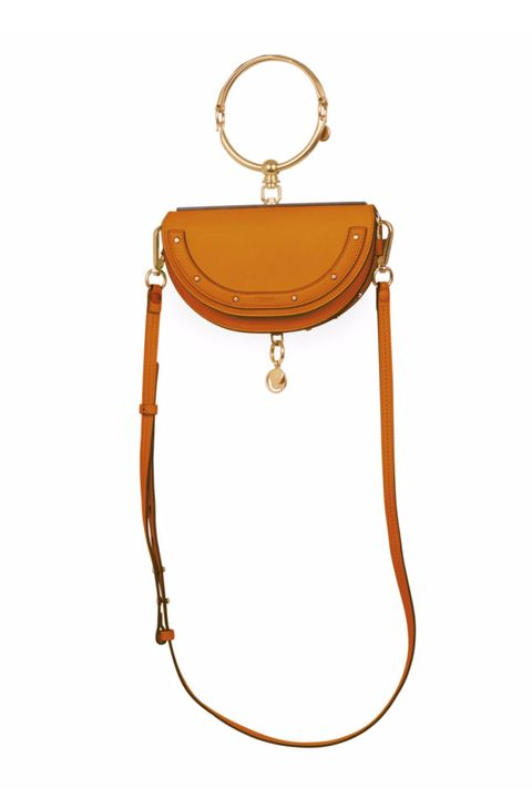 "<p>The breakout handbag star of this festival season, but lends strong Daria Werbowy editorial vibes, as well.&nbsp;</p><p><em data-redactor-tag=""em"" data-verified=""redactor"">Chloé, $1,450</em><span class=""redactor-invisible-space"" data-verified=""redactor"" data-redactor-tag=""span"" data-redactor-class=""redactor-invisible-space""><em data-redactor-tag=""em"" data-verified=""redactor""></em></span><br></p><p><strong data-redactor-tag=""strong"" data-verified=""redactor"">BUY IT:</strong><strong data-redactor-tag=""strong"" data-verified=""redactor"">&nbsp;<a href=""http://www.saksfifthavenue.com/main/ProductDetail.jsp?FOLDER%3C%3Efolder_id=2534374306622829&amp;PRODUCT%3C%3Eprd_id=845524447078757&amp;R=3610927643968&amp;P_name=Chlo%26%23233%3B&amp;N=4294908759+306622829&amp;bmUID=lOumi7X"" target=""_blank"">saksfiftheavenue.com</a>.</strong></p>"