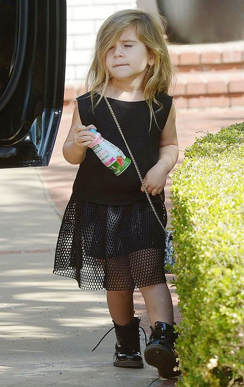 """<p>Some sheerness and patent boots make black on a toddler look not morbid. Also, accessorizing with a smoothie—need to start doing that. *Also* also, <a href=""""http://www.marieclaire.com/fashion/news/a27186/no-more-cross-body-bag/"""" target=""""_blank"""" data-tracking-id=""""recirc-text-link"""">the cross-body bag memorandum</a> does not apply to her.</p>"""