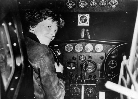 Amelia Earhart in the cockpit of  a plane