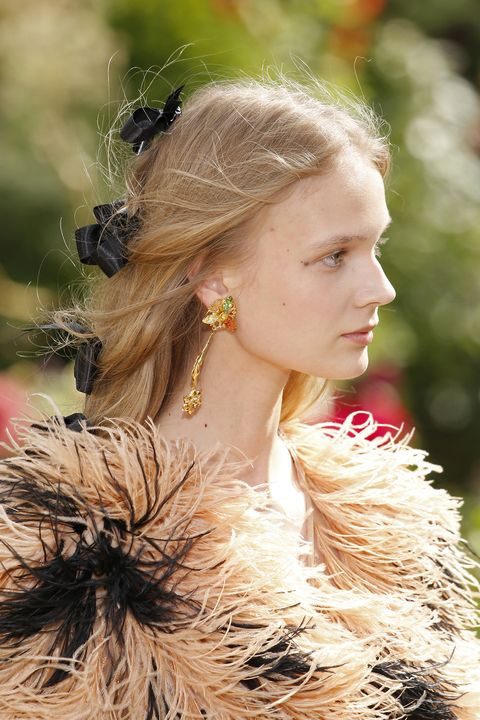 "<p>The <a href=""http://www.marieclaire.com/fashion/a28044/rodartes-spring-2018-collection-flower-crowns/"" target=""_blank"" data-tracking-id=""recirc-text-link"">baby's-breath headdresses</a> would be too extra for anybody but the bride, but you can still join in on the highly decorated fun with a row of neatly tied bows running down the back of your otherwise-loose hair. Dreamy.</p>"