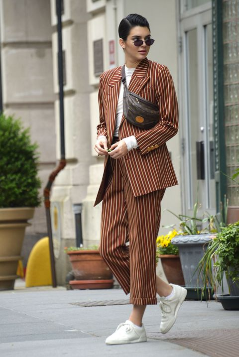 <p>Here, we move up a degree of dressiness with the striped suit and slicked-down hair. Works.</p>