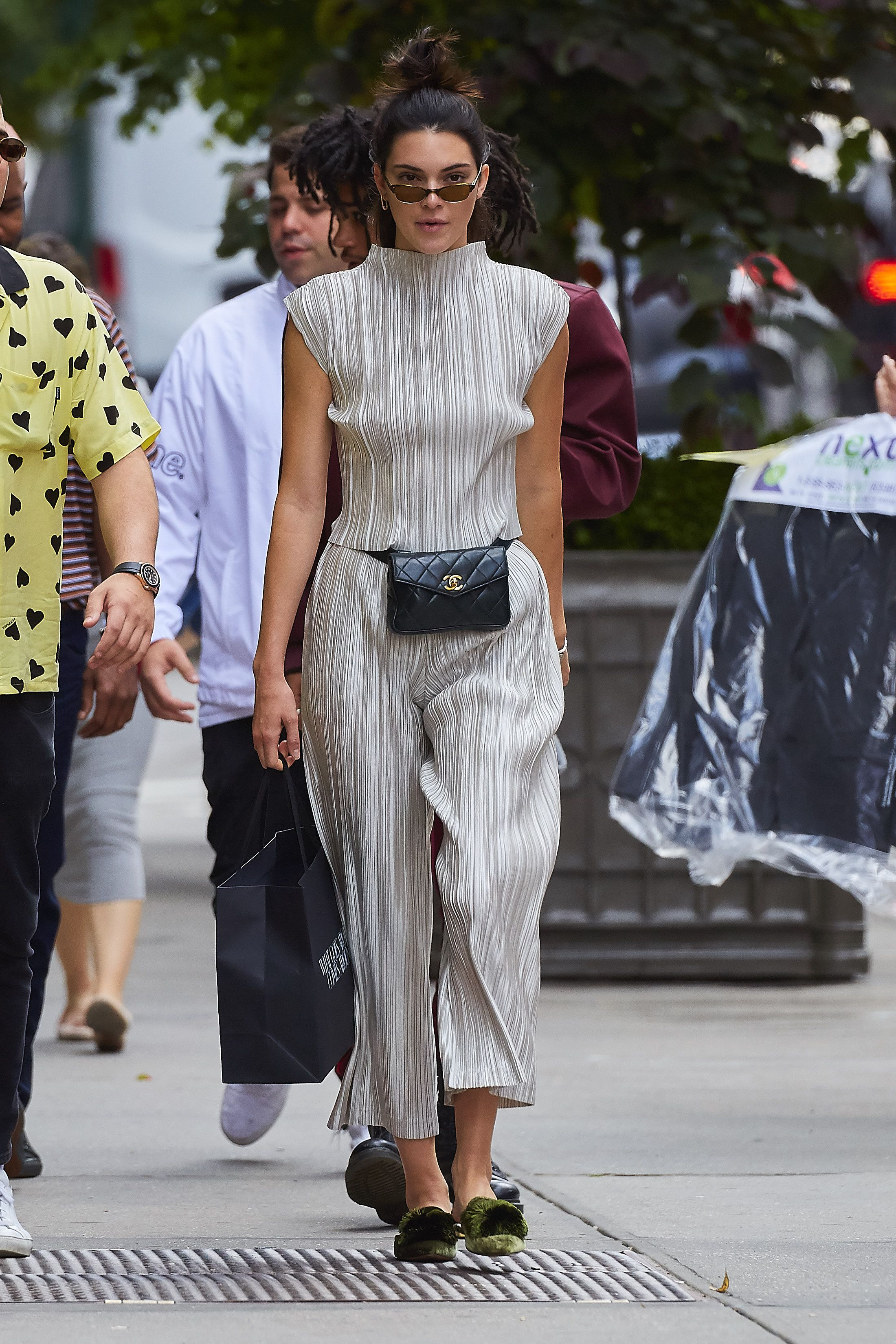 """<p>Also works with pleated evening co-ords, though a vinyl fanny packyou got as a freebie might not cut the mustard.</p><p><em data-redactor-tag=""""em"""" data-verified=""""redactor"""">Shop similar: Gucci, $1,050</em></p><p><span class=""""redactor-invisible-space"""" data-verified=""""redactor"""" data-redactor-tag=""""span"""" data-redactor-class=""""redactor-invisible-space""""><strong data-redactor-tag=""""strong"""" data-verified=""""redactor"""">BUY IT: <a href=""""https://www.net-a-porter.com/us/en/product/897735/Gucci/gg-marmont-quilted-leather-belt-bag"""" target=""""_blank"""" data-tracking-id=""""recirc-text-link"""">net-a-porter.com</a>.</strong></span><br></p>"""
