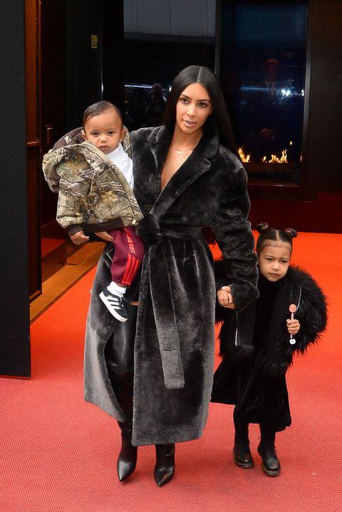 Human body, Fur, Boot, Makeover, Carpet, Overcoat, Velvet, Fashion design, One-piece garment, Handbag,