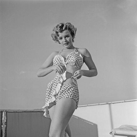 Clothing, Shoulder, Beauty, Black-and-white, One-piece swimsuit, Leg, Leotard, Fashion, Retro style, Swimwear,