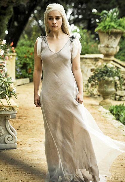 Clothing, Gown, Dress, Wedding dress, White, Photograph, Bridal clothing, Bridal party dress, Fashion model, Beauty,