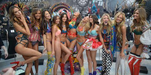 Footwear, Leg, Entertainment, Thigh, Fashion, Carnival, Public event, Fashion model, Costume, Dance,