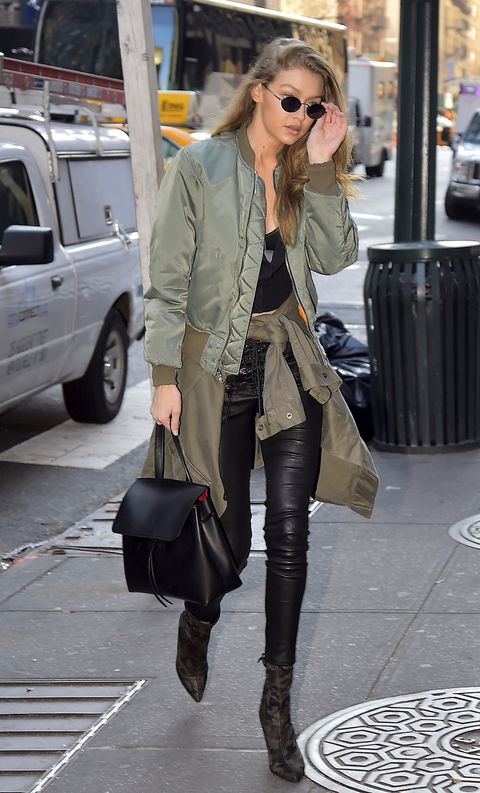 """<p>Speaking of layering, here, we've got an outfit that's <em data-redactor-tag=""""em"""" data-verified=""""redactor"""">suggests</em> something more. That is, with one bomber on, and another jacket around her waist, we're reminded of the most elegant—but often forgotten—anti-frostbite solution of wearing two coats at once.&nbsp&#x3B;</p>"""