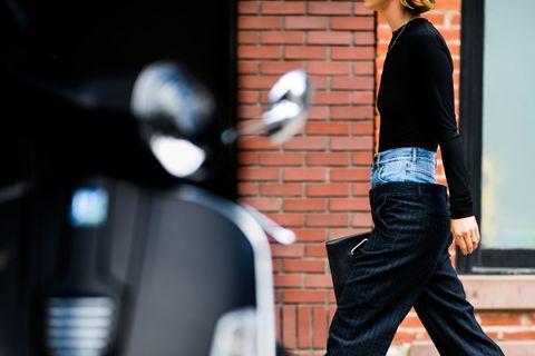 Standing, Street fashion, Jeans, Leg, Fashion, Human, Sitting, Shoulder, Footwear, Waist,