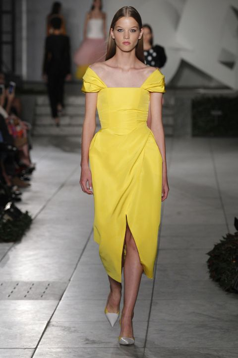 Fashion model, Fashion, Fashion show, Clothing, Shoulder, Yellow, Dress, Runway, Haute couture, Joint,