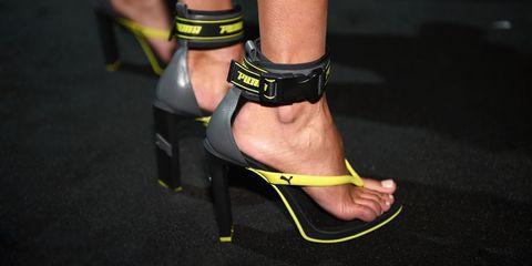 Footwear, Shoe, Leg, Yellow, High heels, Ankle, Sandal, Foot, Joint, Human leg,