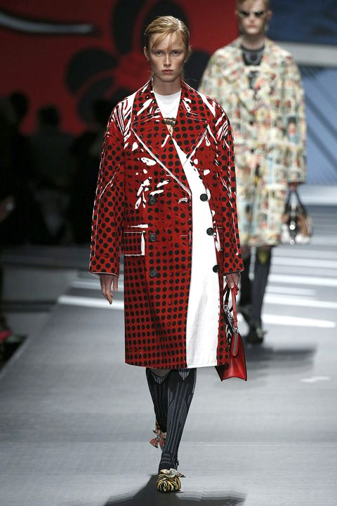 "<p>This is for more of an entrance-making scenario, but in a red patent slicker (preferably Prada), you don't even have to toss it onto someone's desk for everybody to go ""gird your loins."" And given that <a href=""http://www.marieclaire.com/career-advice/news/a15322/office-cold-air-conditioning/"" target=""_blank"" data-tracking-id=""recirc-text-link"">air-conditioning is sexist</a>, it wouldn't be so weird if you kept it on.</p><p><em data-redactor-tag=""em"" data-verified=""redactor"">Shop similar: Topshop, $170</em></p><p><strong data-redactor-tag=""strong"">BUY IT:&nbsp;</strong><span class=""redactor-invisible-space"" data-verified=""redactor"" data-redactor-tag=""span"" data-redactor-class=""redactor-invisible-space""><strong data-redactor-tag=""strong""><a href=""http://us.topshop.com/en/tsus/product/clothing-70483/jackets-coats-2390895/vinyl-trench-coat-6926592?bi=0&amp;ps=20"" target=""_blank"" data-tracking-id=""recirc-text-link"">topshop.com</a>.</strong></span><span class=""redactor-invisible-space"" data-verified=""redactor"" data-redactor-tag=""span"" data-redactor-class=""redactor-invisible-space""></span></p>"