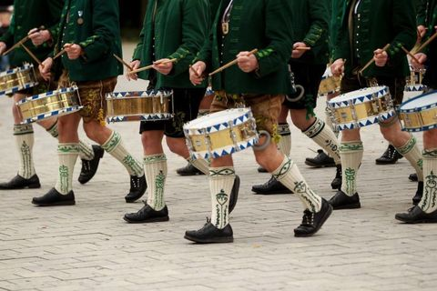 Footwear, Musical instrument, Musician, Membranophone, Uniform, Parade, Performing arts, Drum, Team, Performance,