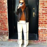 Clothing, Brown, Brick, Goggles, Standing, Photograph, White, Wall, Brickwork, Sunglasses,