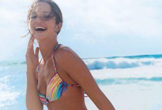 girl on beach in rainbow bikini
